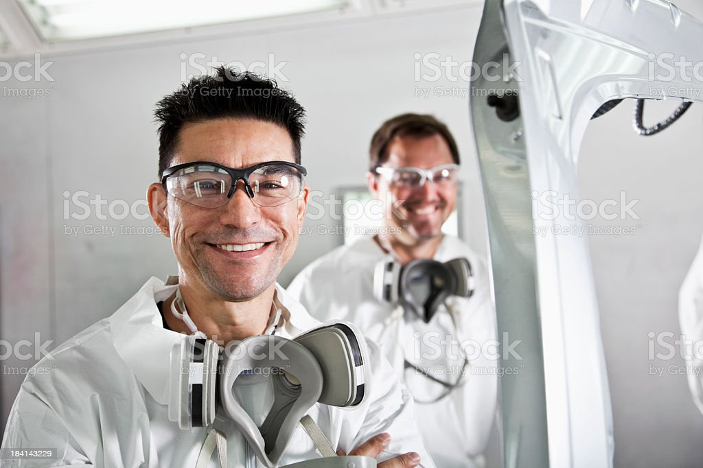 Workers in auto body shop stock photo