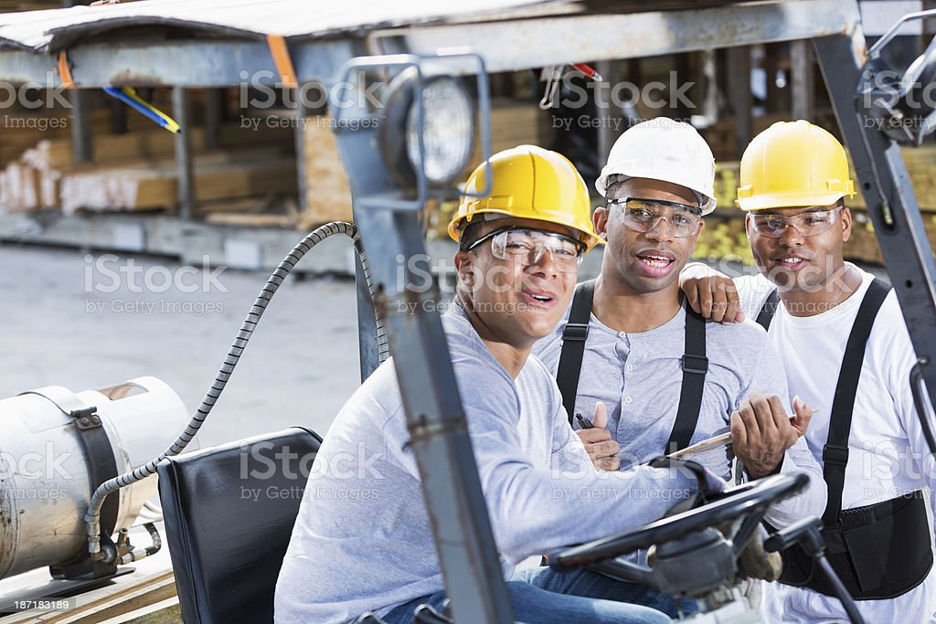 Workers in building supply store royalty-free stock photo