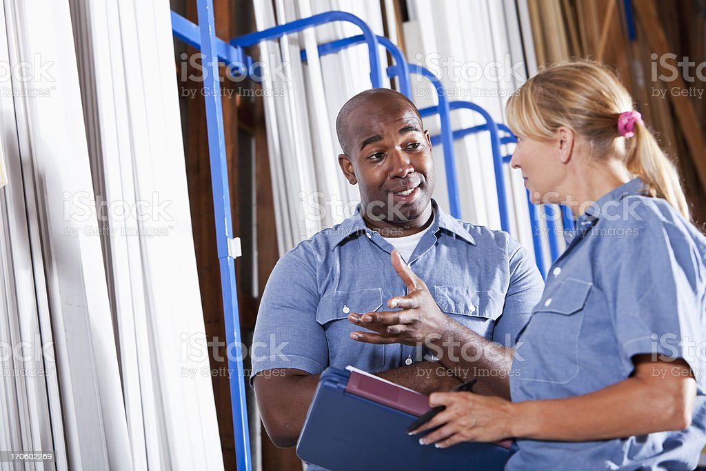Workers in building supply store taking inventory royalty-free stock photo