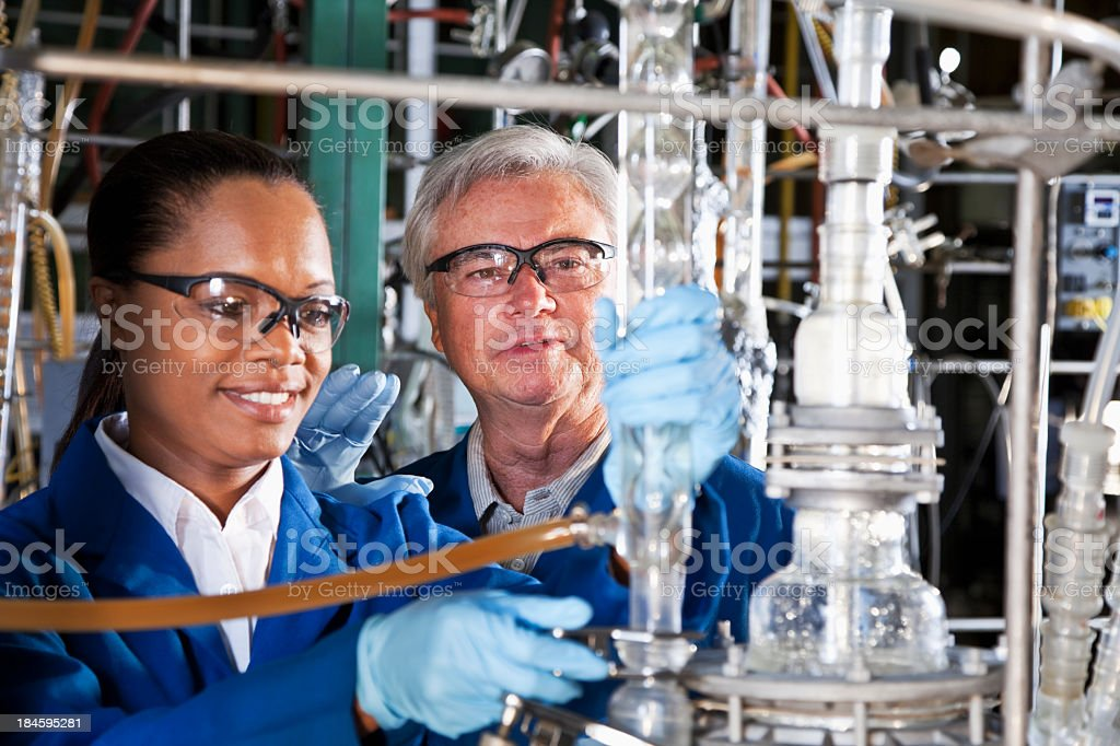 Workers in chemical plant stock photo