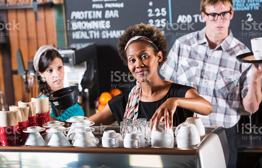 Workers in coffee shop stock photo