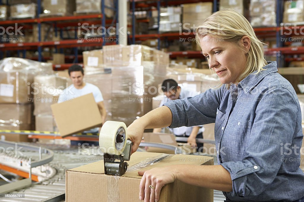Workers In Distribution Warehouse royalty-free stock photo