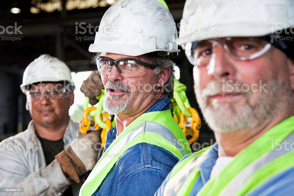 Workers in factory royalty-free stock photo