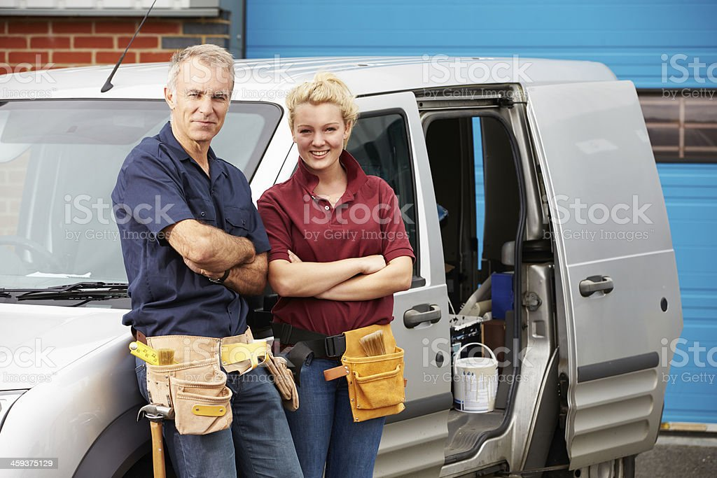 Workers In Family Business Standing Next To Van stock photo