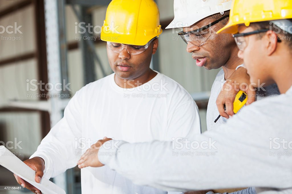 Workers in hardhats stock photo