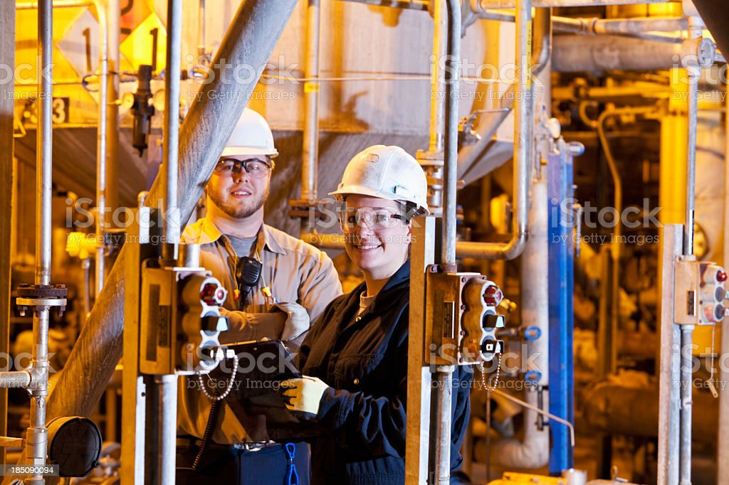 Workers in industrial plant royalty-free stock photo