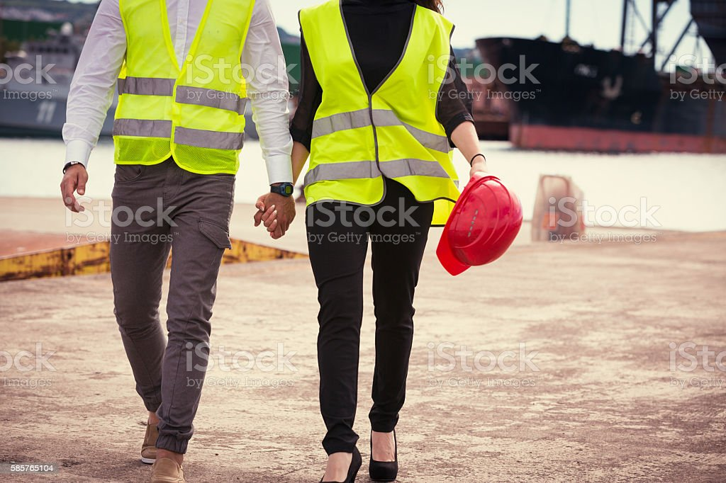 workers in industrial port stock photo