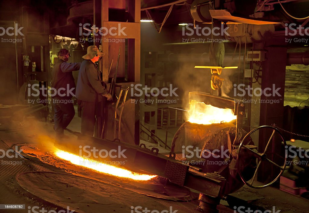 Workers in Iron Foundry stock photo