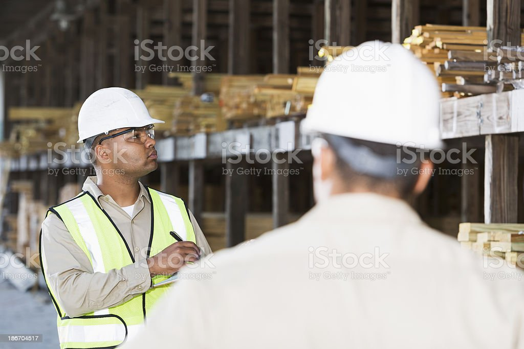 Workers in lumber yard royalty-free stock photo