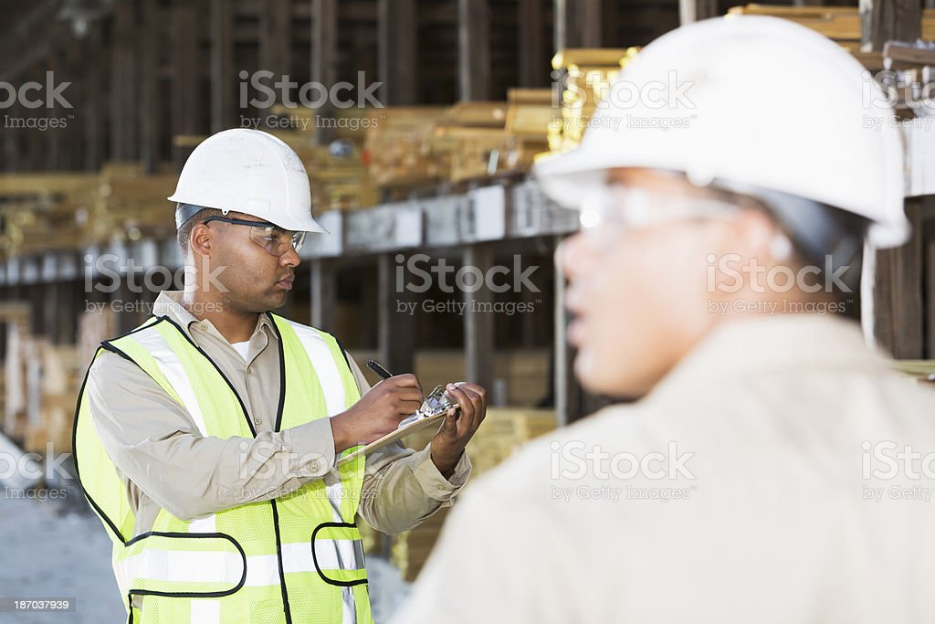 Workers in lumber yard stock photo