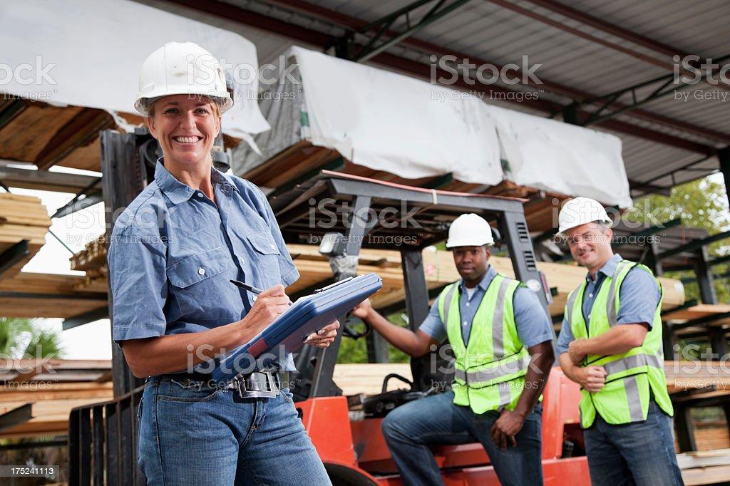 Workers in lumberyard stock photo