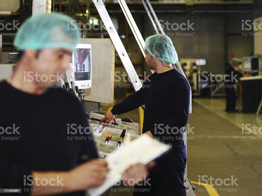 Workers in printing plant royalty-free stock photo