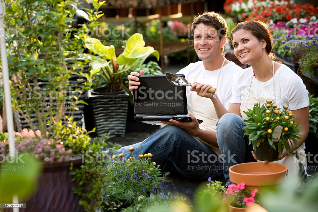 Workers in retail garden center with laptop royalty-free stock photo