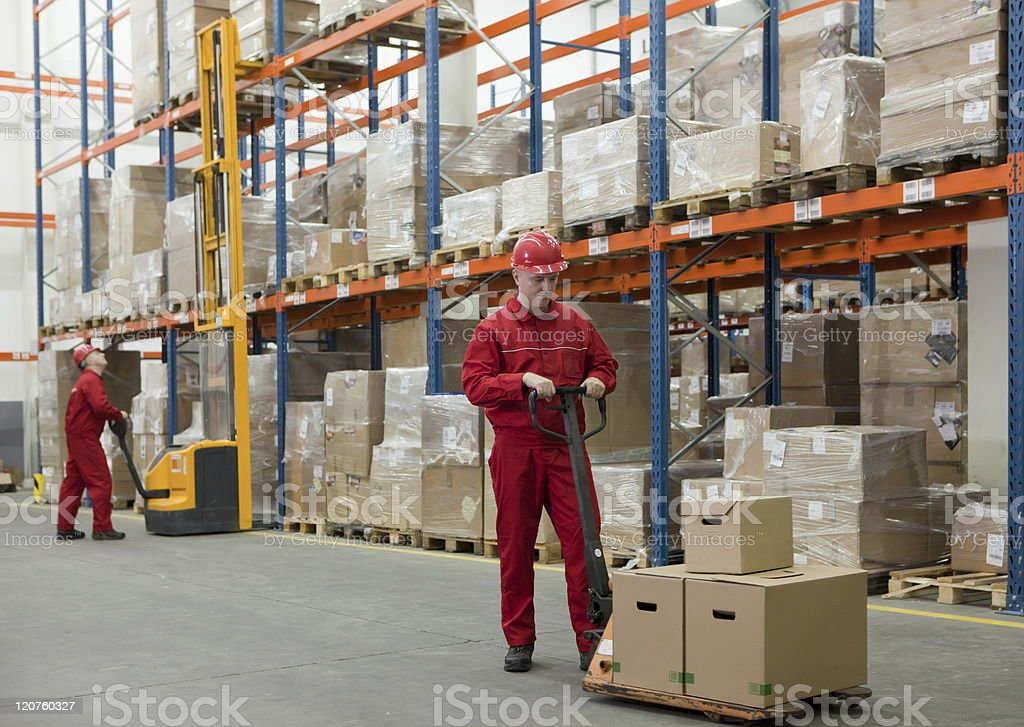Workers in storehouse royalty-free stock photo