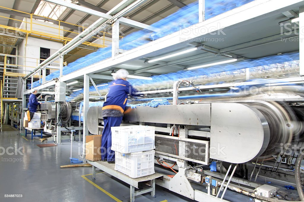 Workers in the PVC gloves production lines stock photo