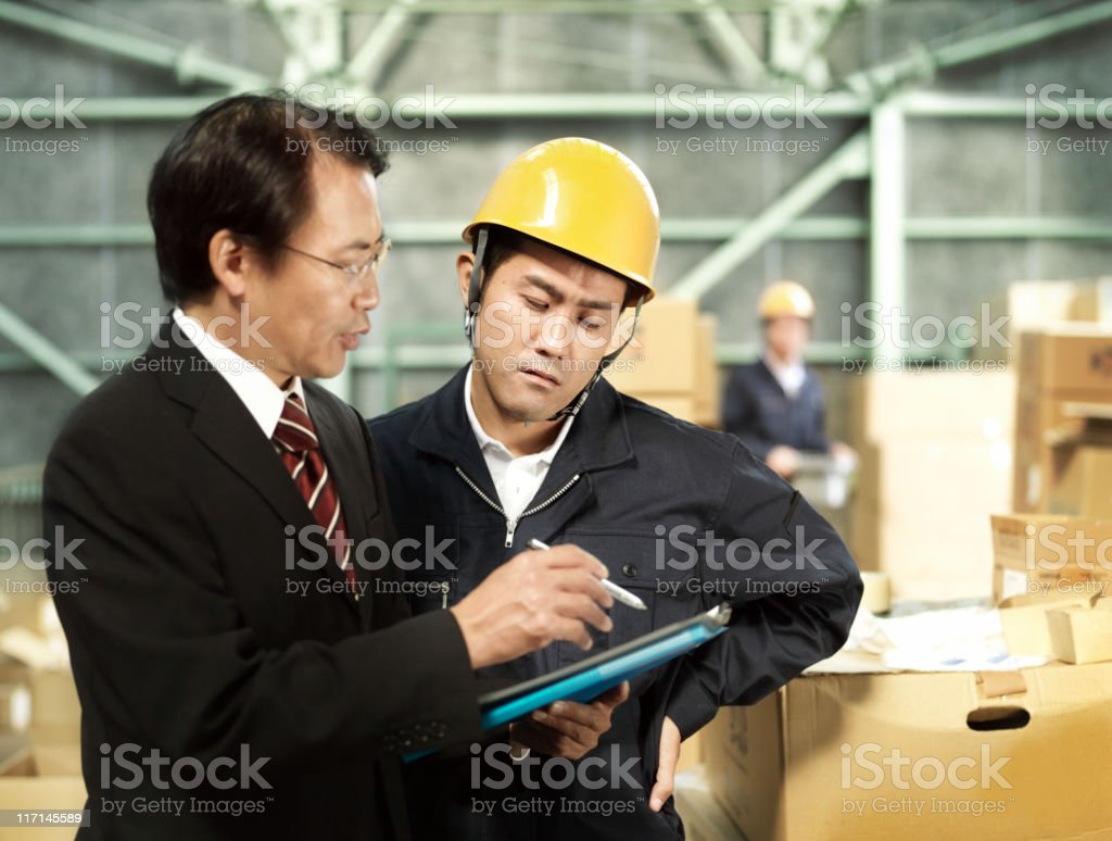 Workers in warehouse royalty-free stock photo
