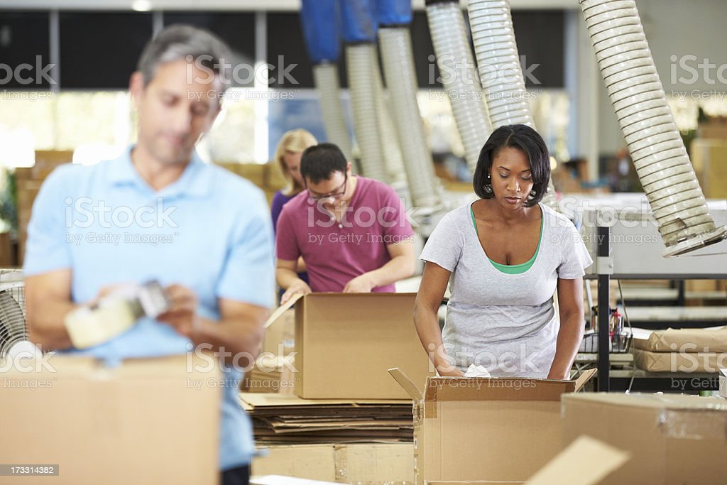 Workers In Warehouse Preparing Goods For Dispatch royalty-free stock photo