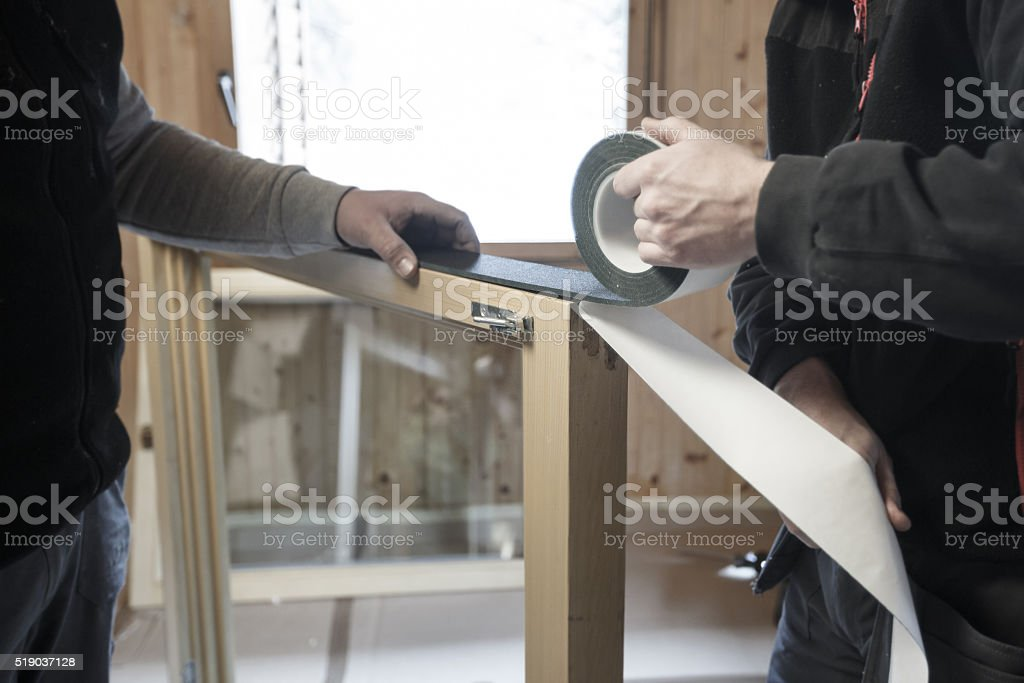 Workers installing new windows stock photo