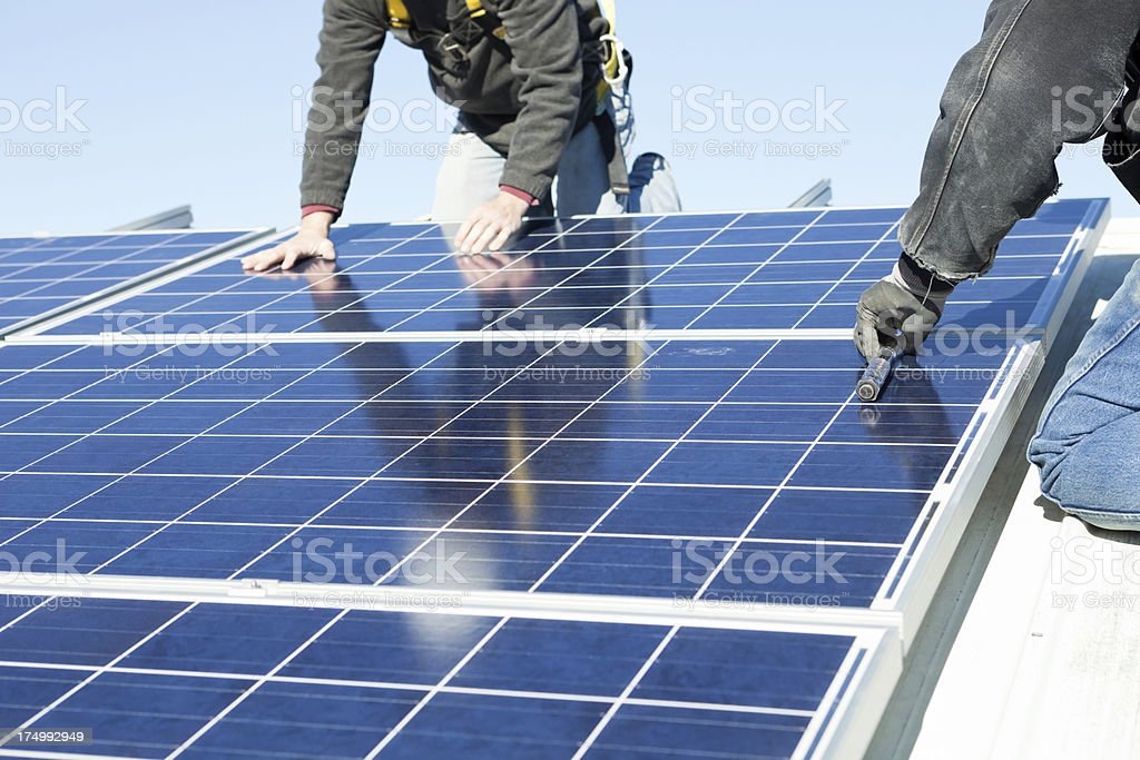 Worker's Installing Rooftop Solar Panels royalty-free stock photo
