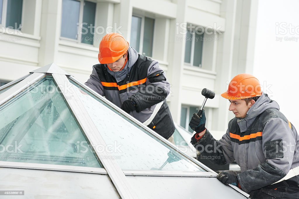 workers installing window stock photo