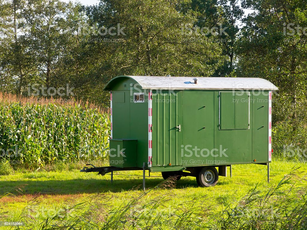 Workers lunch shelter amid green landscape stock photo
