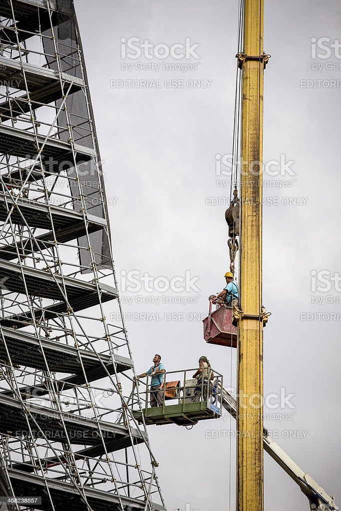 Workers on a crane royalty-free stock photo
