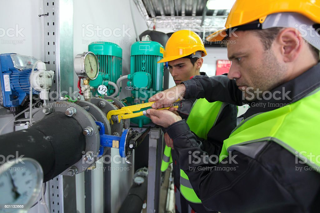 Workers on Plant stock photo