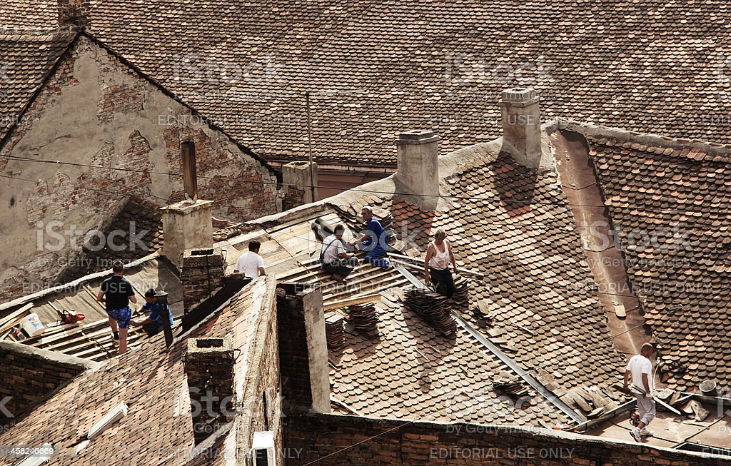 Workers on the old roof royalty-free stock photo