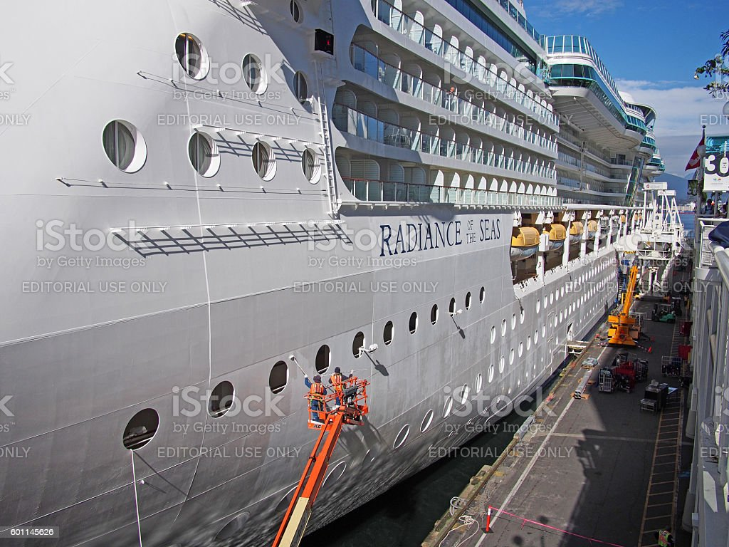 Workers Painting the Radiance of the Seas in Vancouver Canada stock photo