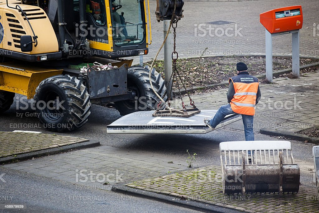 Workers placing a speed bump stock photo