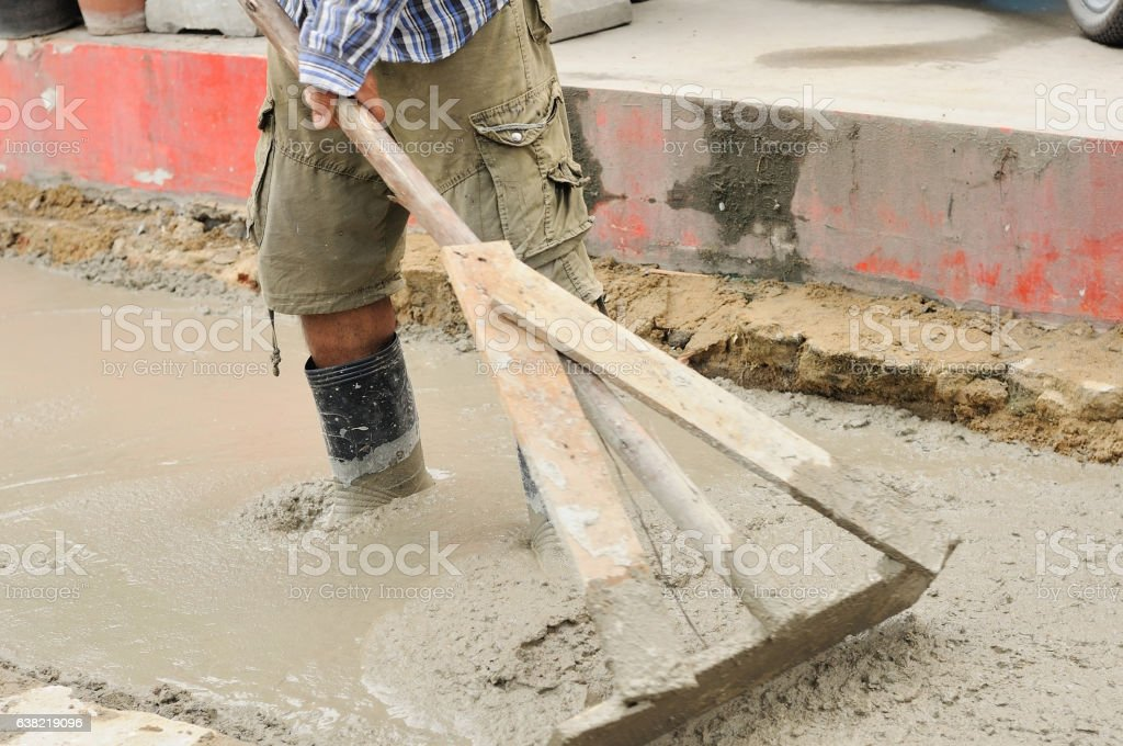 Workers poured and adjust concrete sidewalk stock photo