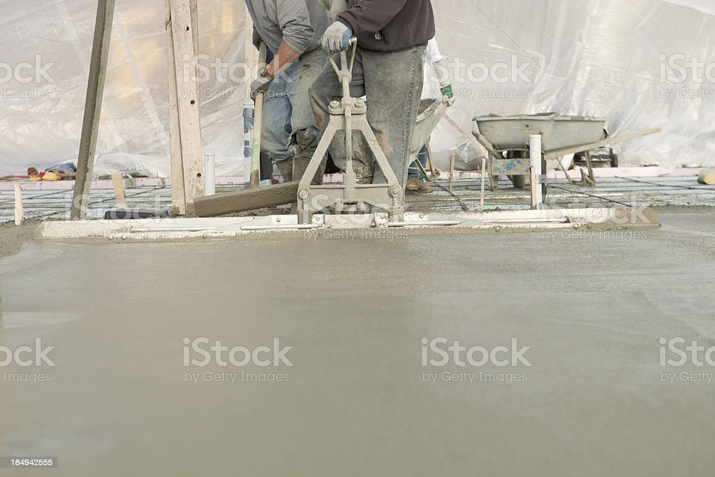 Workers Pouring a Concrete House Foundation Slab stock photo