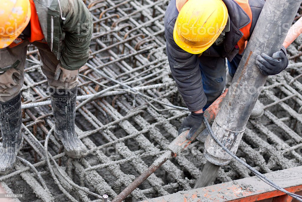 Workers pouring concrete stock photo