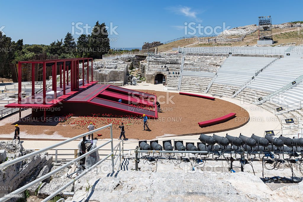 Workers preparing stage in the Greek theatre of Syracusa, Sicily stock photo