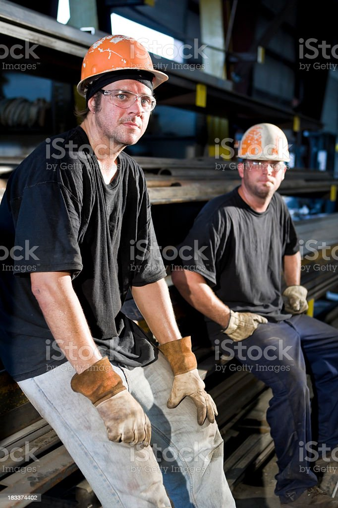 Workers resting in warehouse storage area stock photo
