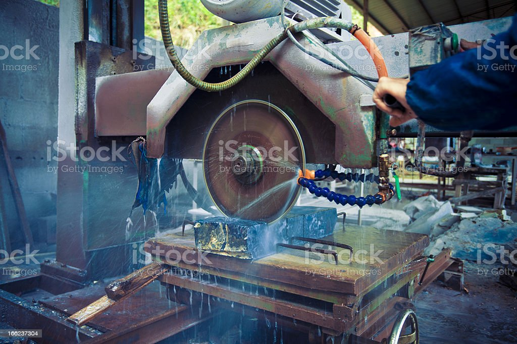 Workers saw a stone royalty-free stock photo