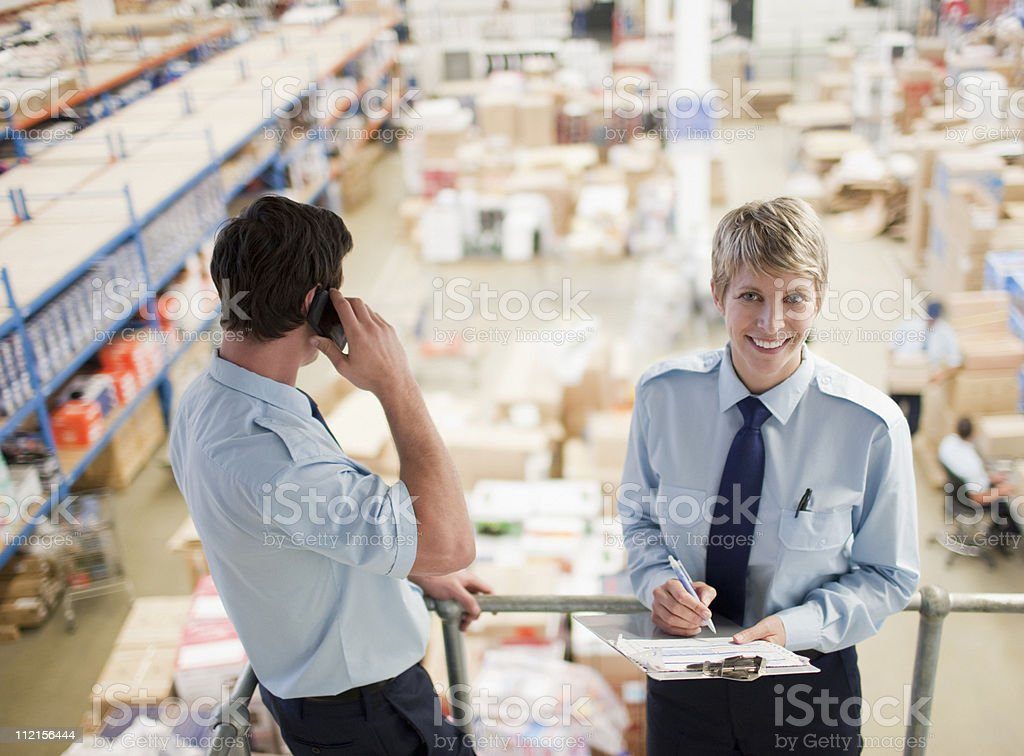 Workers standing together above shipping area royalty-free stock photo