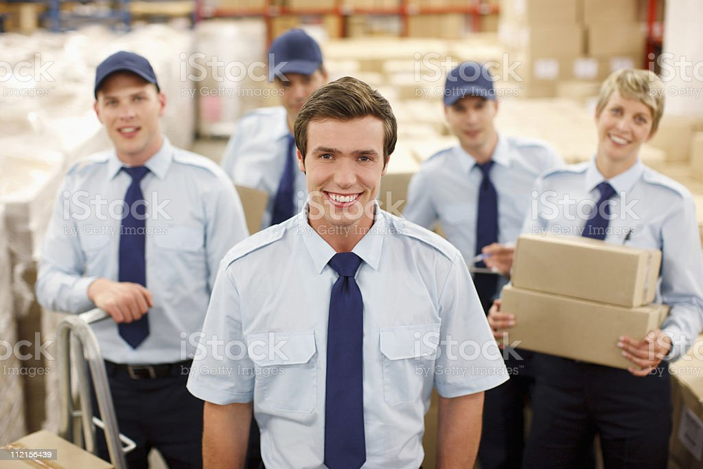 Workers standing together in shipping area royalty-free stock photo