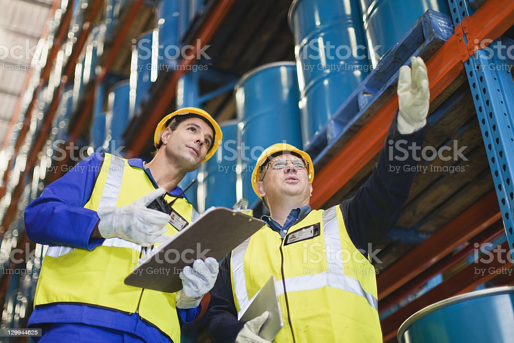 Workers talking in warehouse stock photo