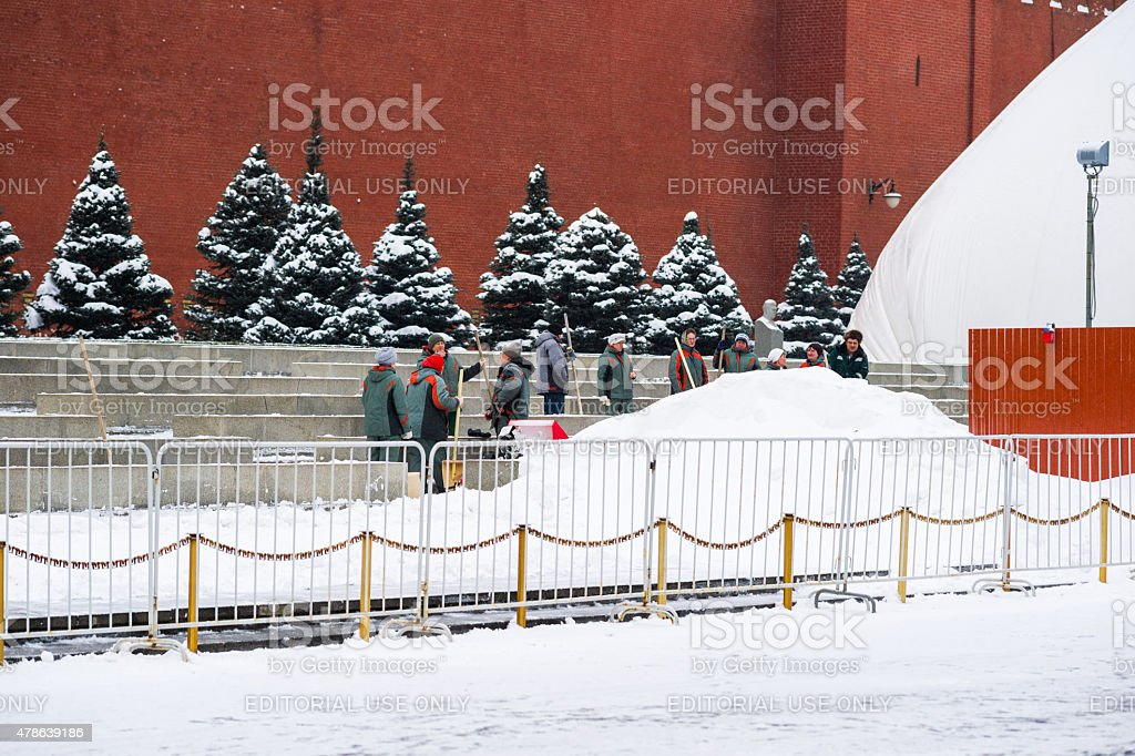 Workers to remove snow from Red Square of Moscow stock photo