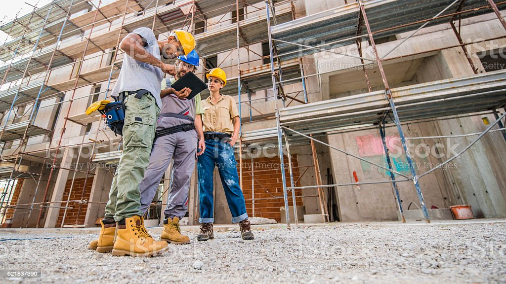 Workers using digital tablet stock photo