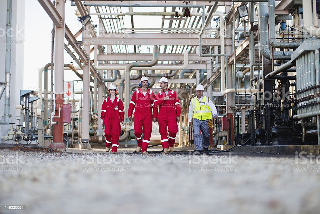 Workers walking at chemical plant stock photo