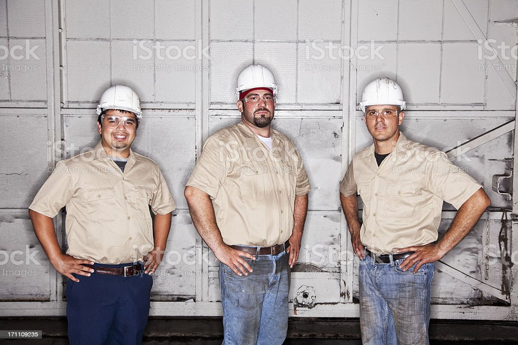 Workers wearing hardhats royalty-free stock photo