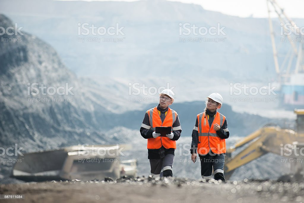 Workers with coal at open pit stock photo