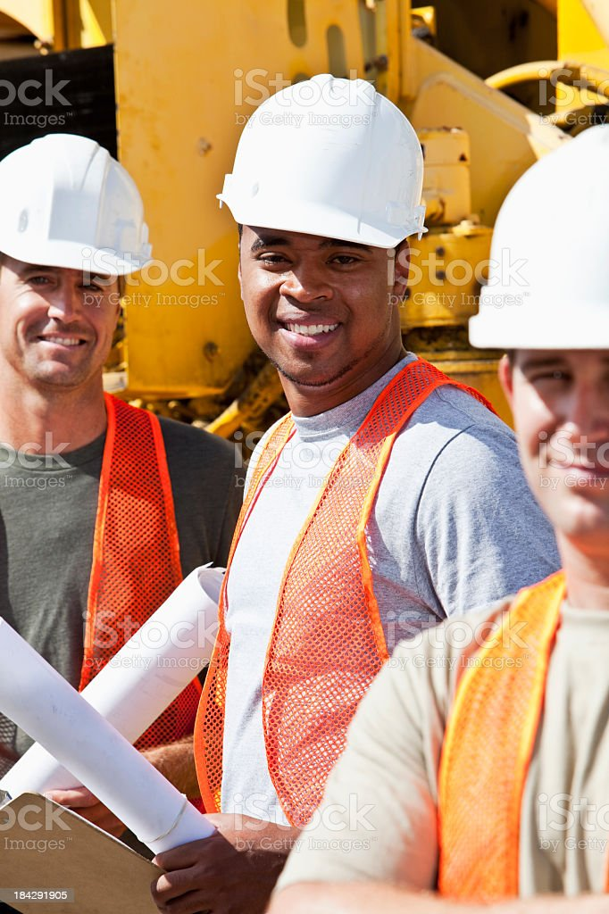 Workers with heavy machinery stock photo