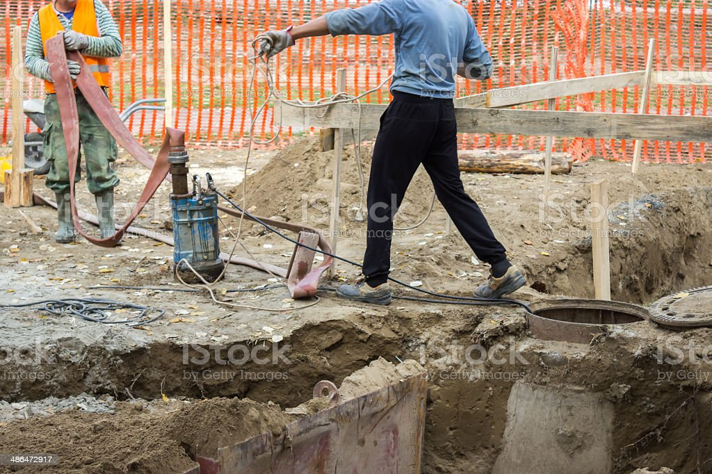 workers with Industrial Submersible Water Pump 2 stock photo