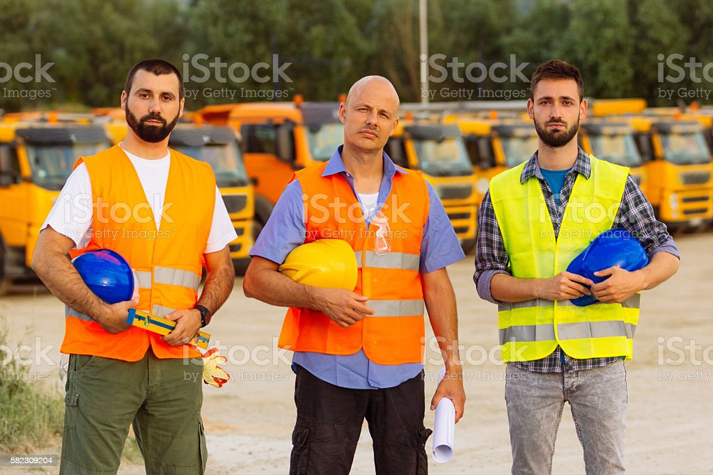 Workers without hard hats on construction site stock photo