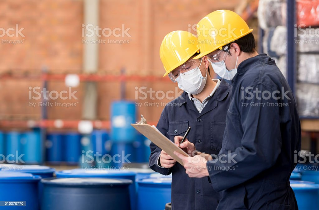 Workers working at a chemical plant stock photo