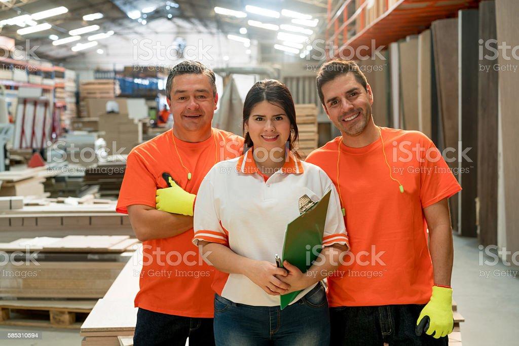 Workers working at a lumberyard stock photo