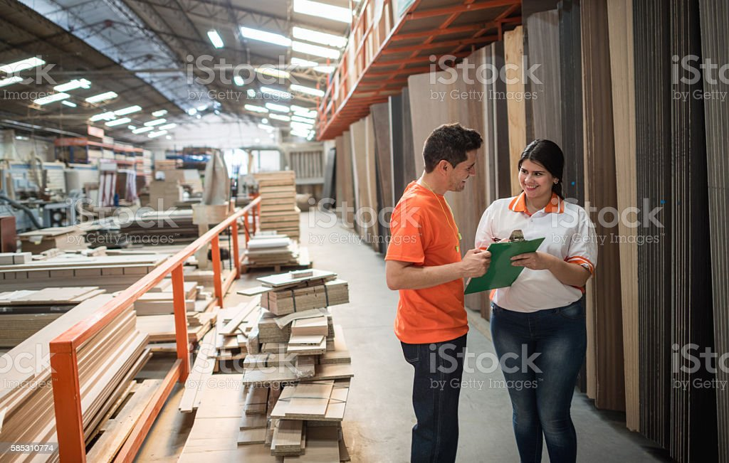 Workers working at a lumberyard stock photo